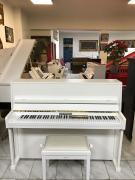 Bílé pianino RIPPEN.