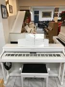 Zánovní bílé digitální piano KAWAI.